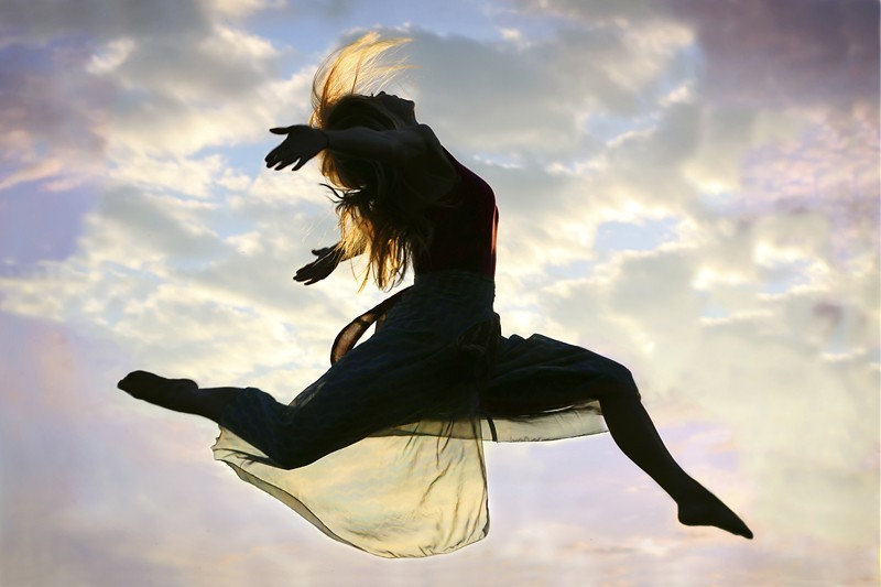 Woman Jumping through the Air
