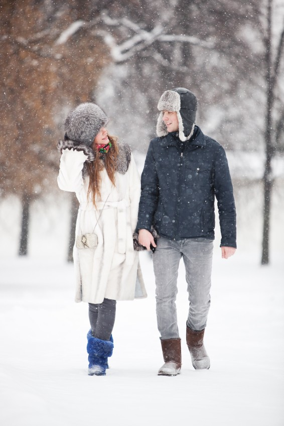 Young couple walking in a park. Winter season.